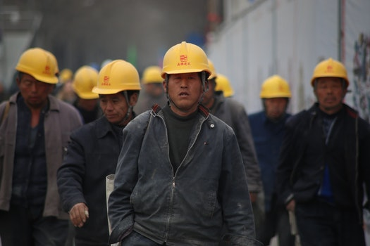 Group of Persons Wearing Yellow Safety Helmet during Daytime