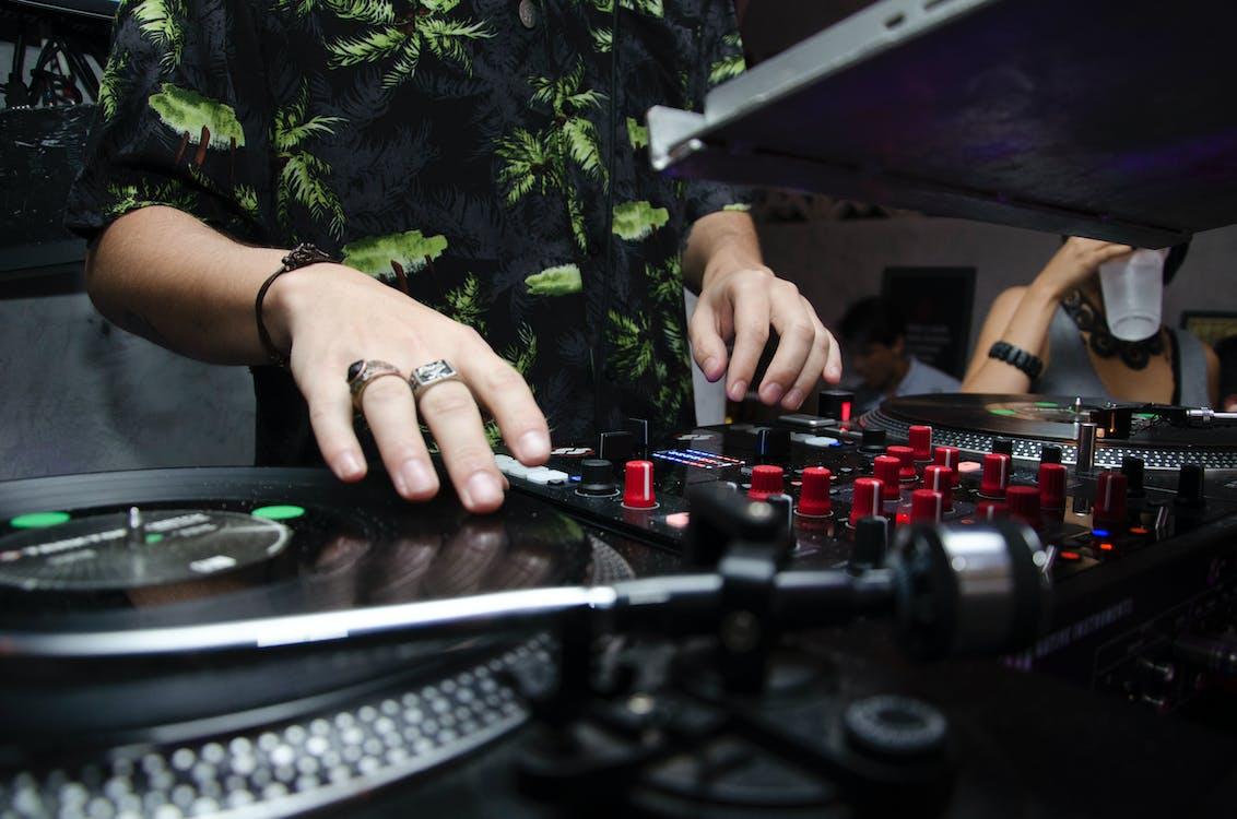 Man Playing Music Mixer and Dj Mixer