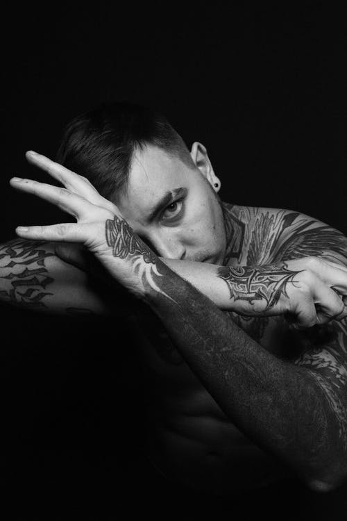 Grayscale Photography of Topless Man With Body Tattoo