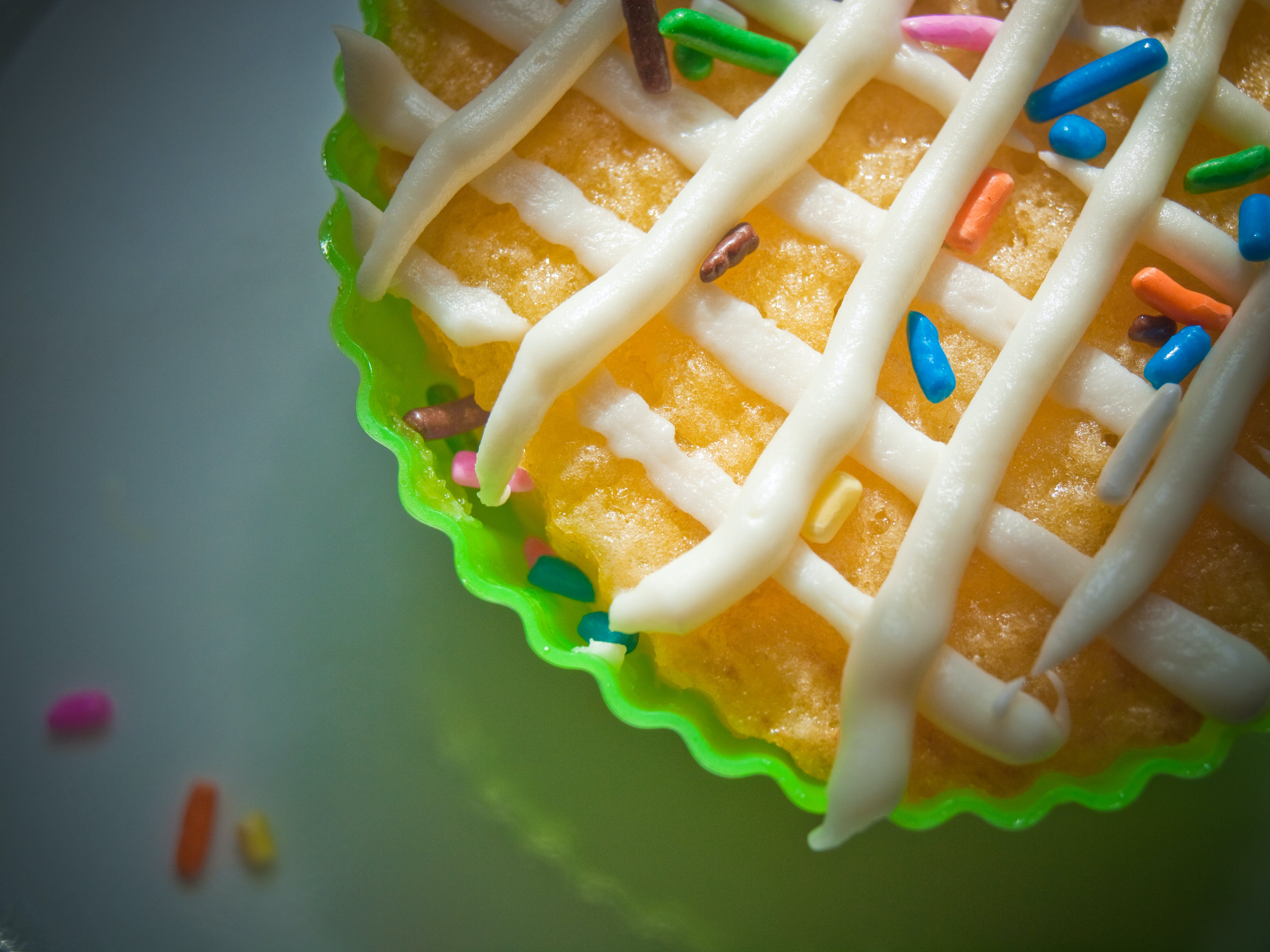 Cupcake With Candy Sprinklers on White Surface