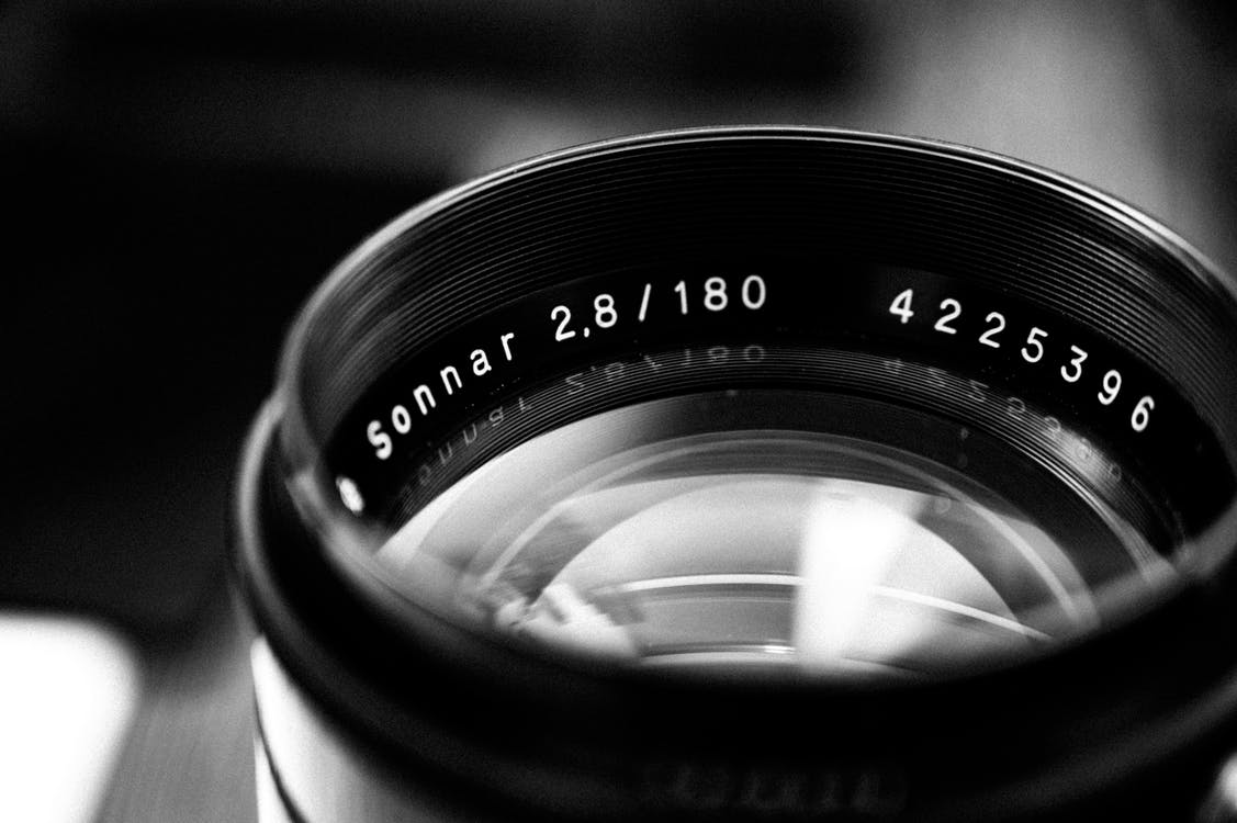 Black Camera Lens in Grayscale Photography