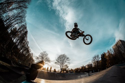 Person Riding Bike While in Mid Air in Skate Par