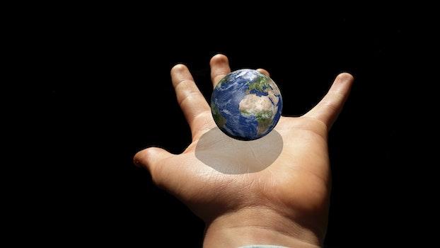 Free stock photo of hand, earth, globe, planet