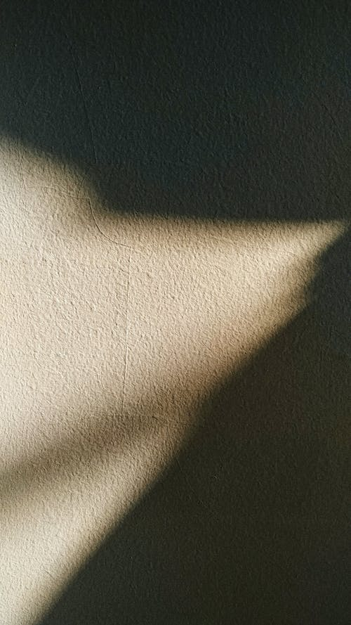 Shadow and sun light on gray wall