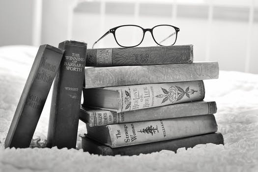 Free stock photo of black and white books vintage stack