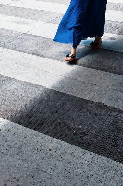 Photo of person walking on pedestrian lane
