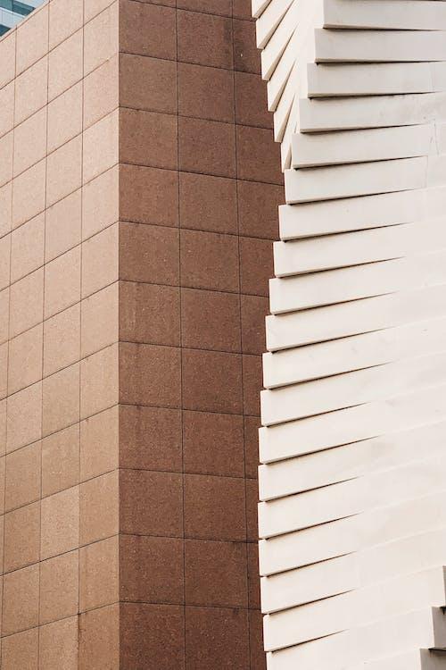 Gratis lagerfoto af arkitektdesign, arkitektur, beton, brun baggrund