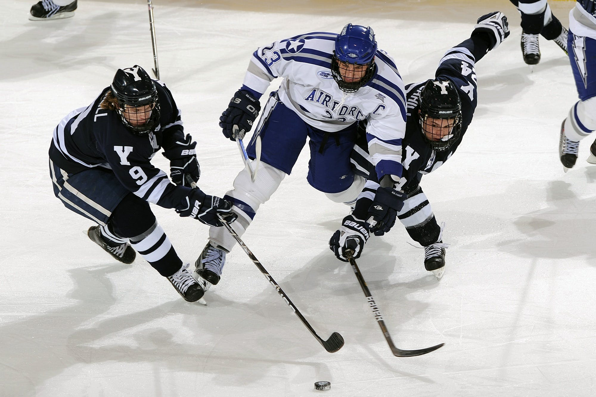 Men's in Blue and White Jersey Shirt Playing Hockey