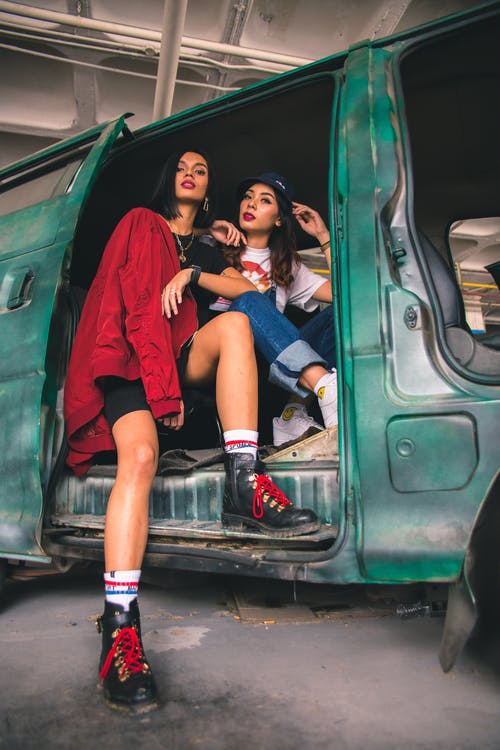 Two Women Sitting in Vehicle