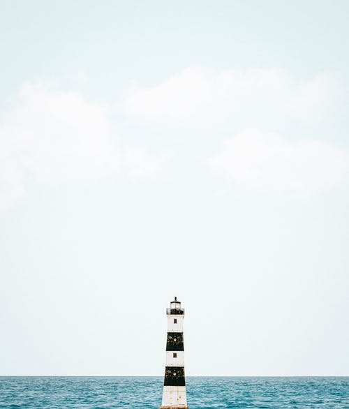 Photo Of Lighthouse Near Sea