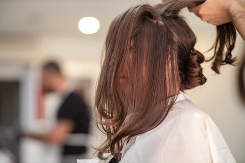 Shallow Focus Photo of Person Fixing Hair
