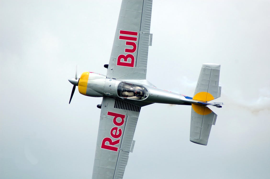 Gray Red Bull Monoplane on Mid Air
