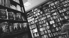 black-and-white, person, books