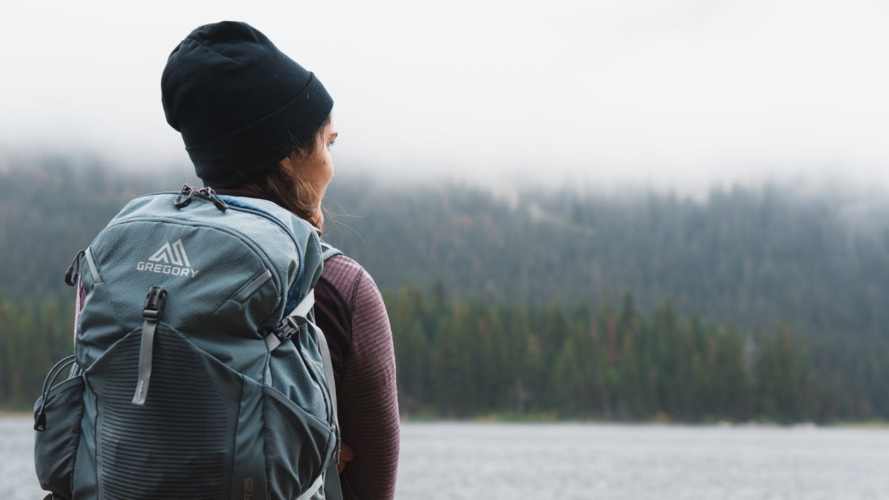 Close-up Photography of Woman Carrying Gray Backpack