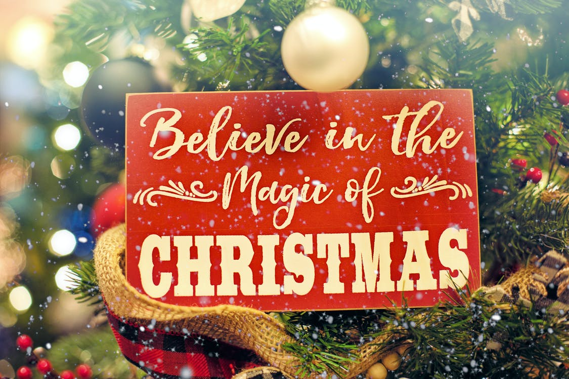 Shallow Focus Photo of Believe in the Magic of Christmas Signage