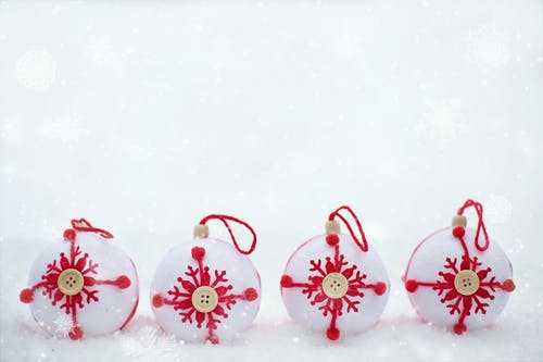 Four White And Red Christmas Baubles