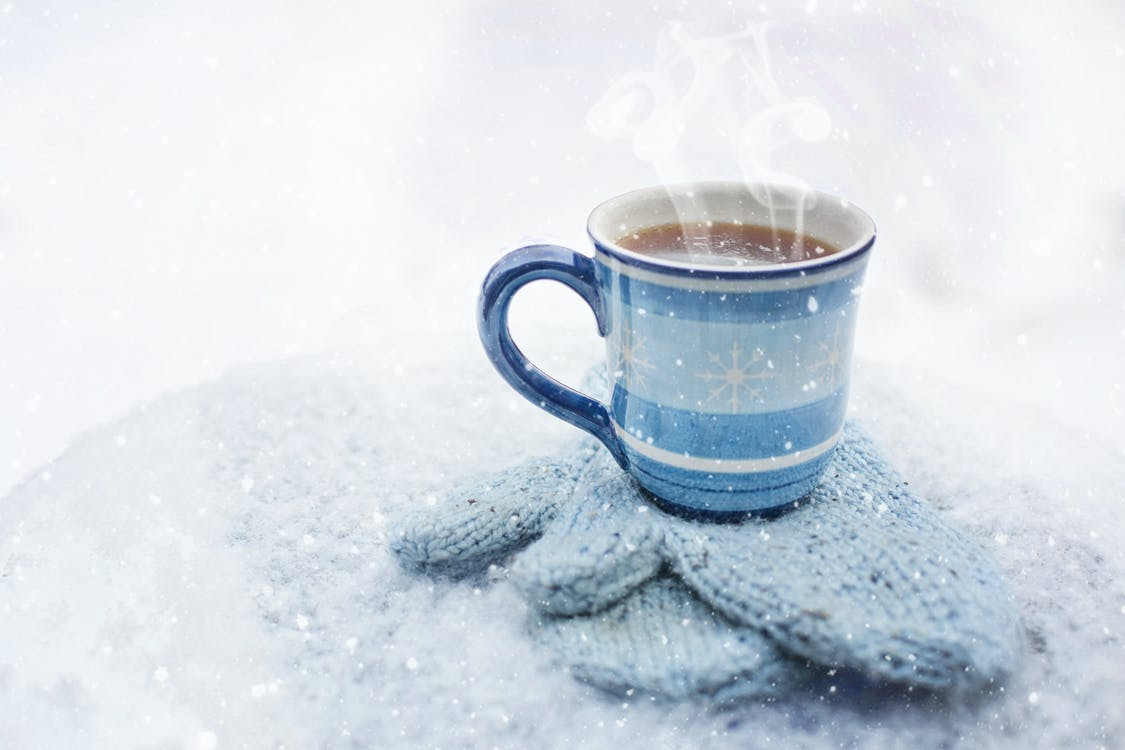 Blue Ceramic Cup Filled With Liquid