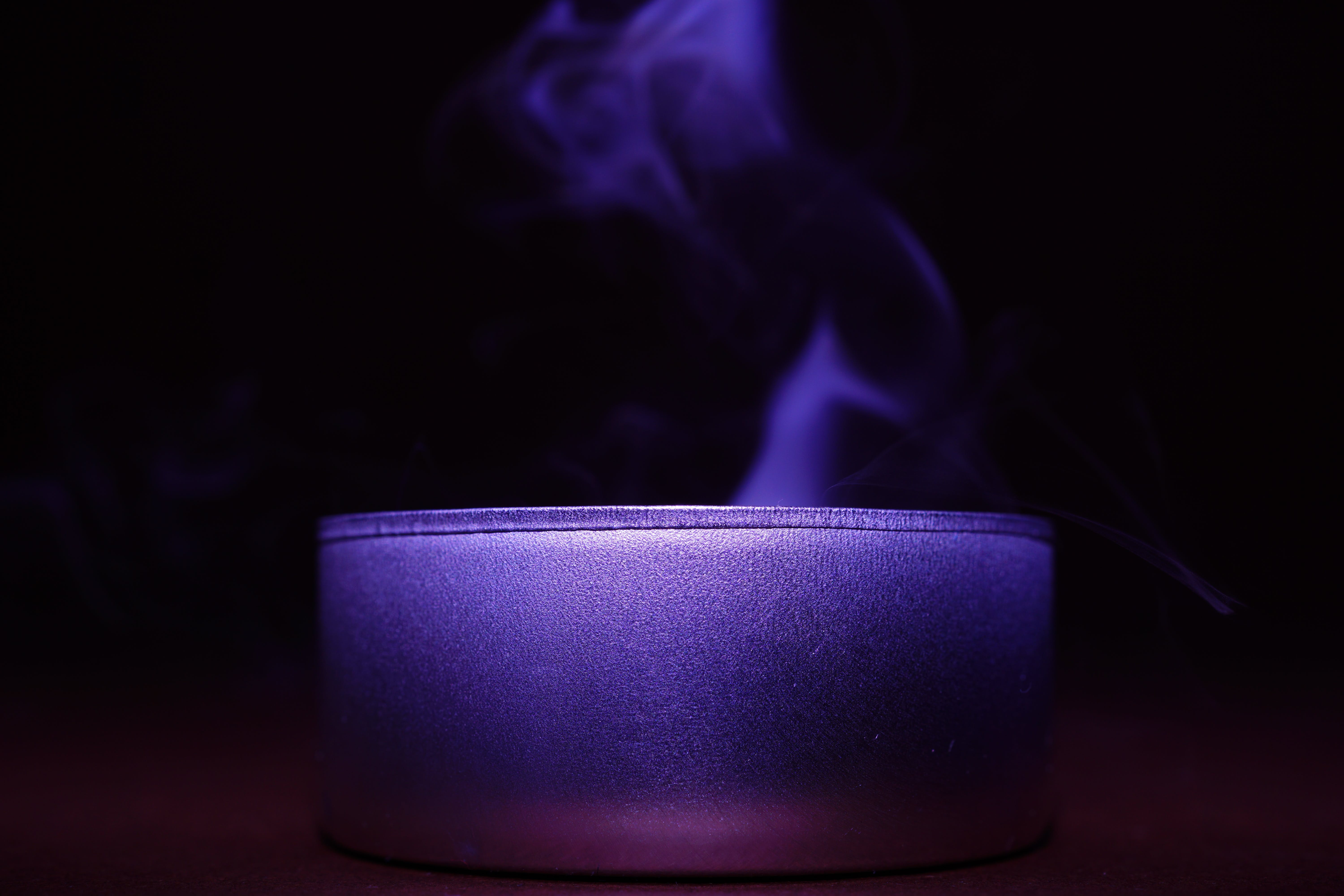 Close-up of Blue Candle Against Black Background