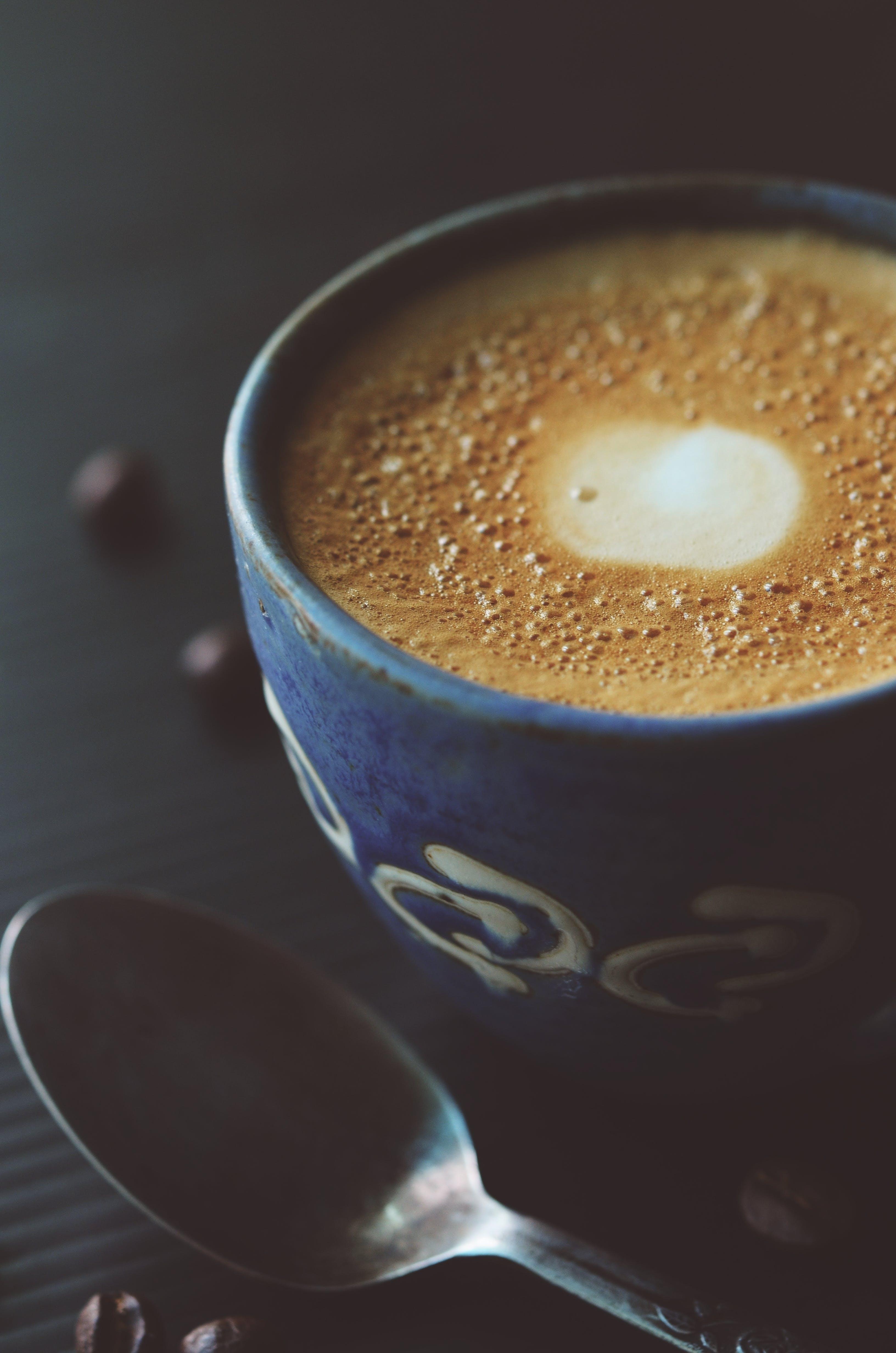 Stainless Steel Spoon Beside Blue Ceramic Coffee Mug