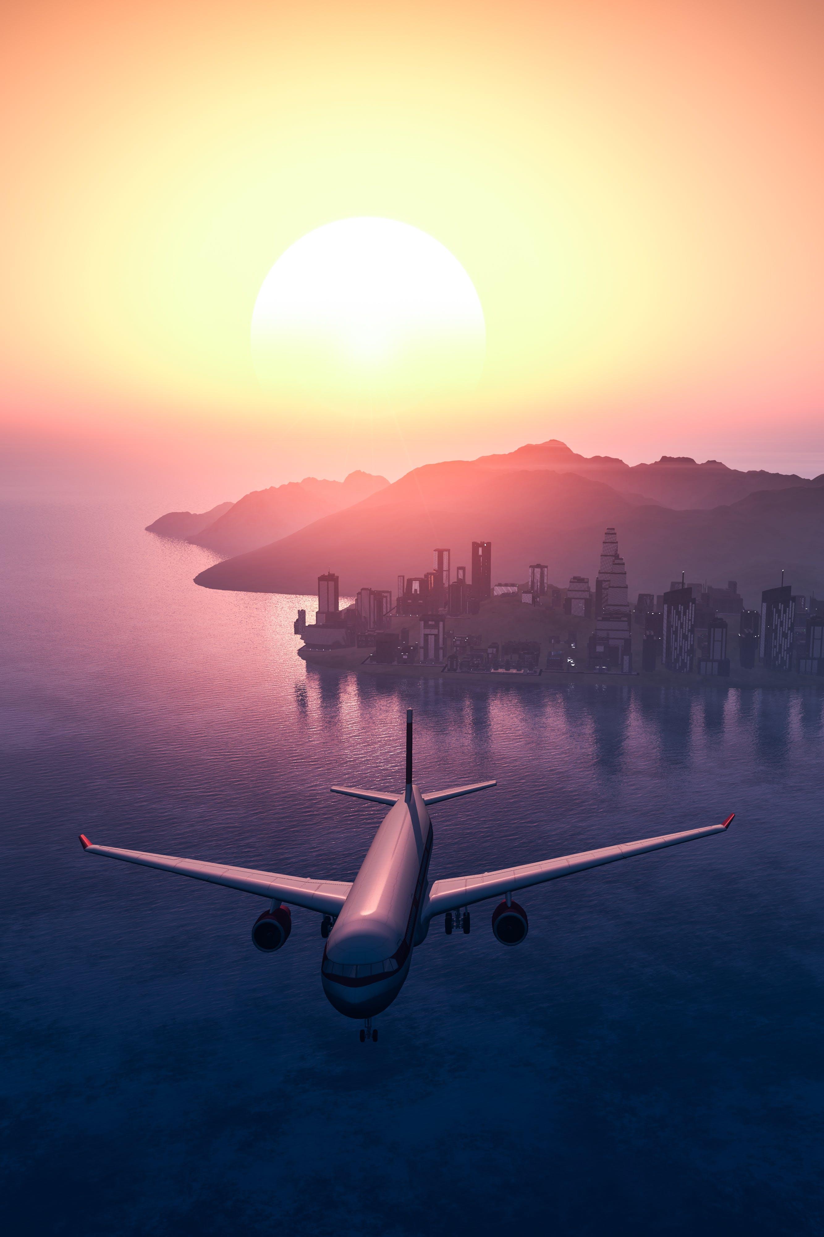 Darmowe zdjęcie z galerii z blask słońca, lot, lotnictwo, miasto