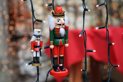 Shallow Focus Photo of Nutcrackers Figurine