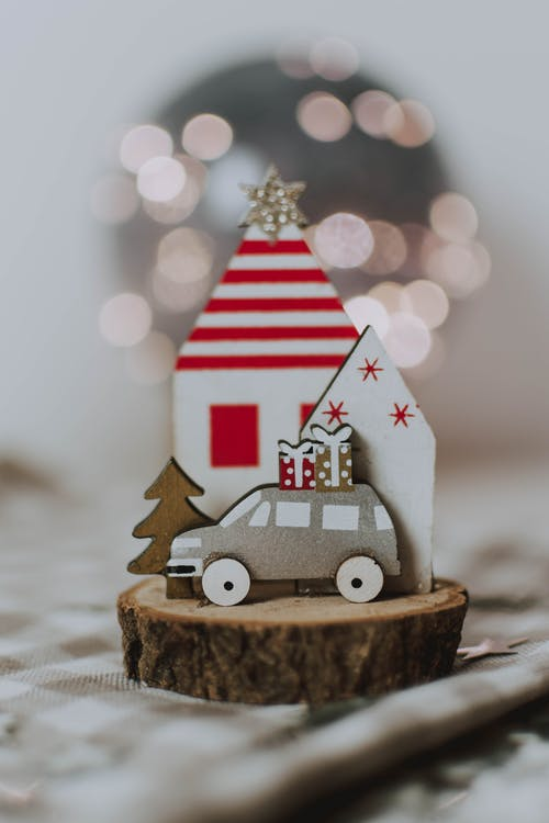 Photo Of Miniature Houses On Toy Of Wooden Log