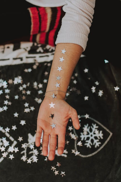 Photo Of Person Hand's With Stars