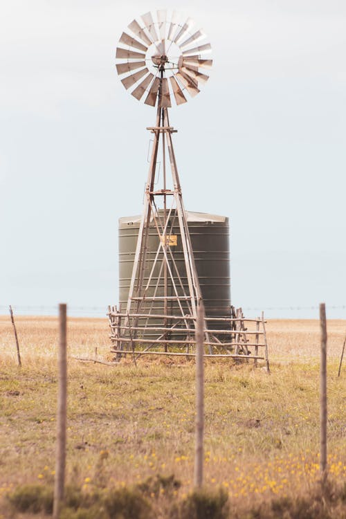 Gray Windmill on Brown Field