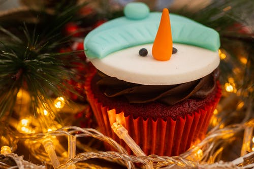 Snowman Cupcake Near String Lights