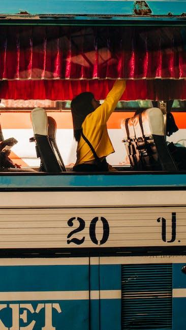 Woman sitting inside a bus