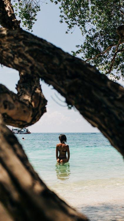 Woman Wearing Bikini Standing in Seashore