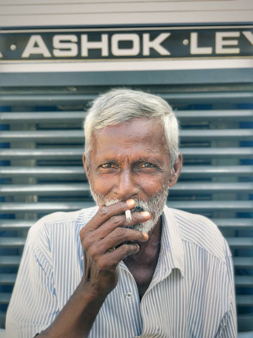 Photo Of Man Smoking Cigarette
