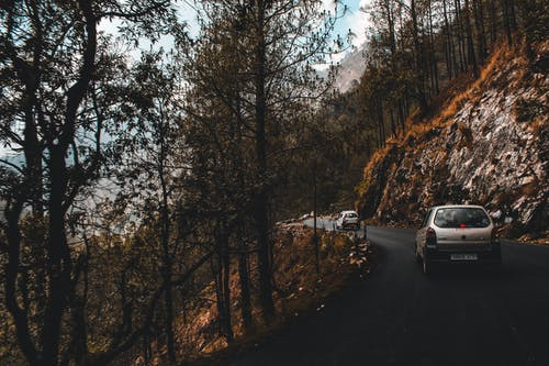 White Cars on Road Near A Cliff