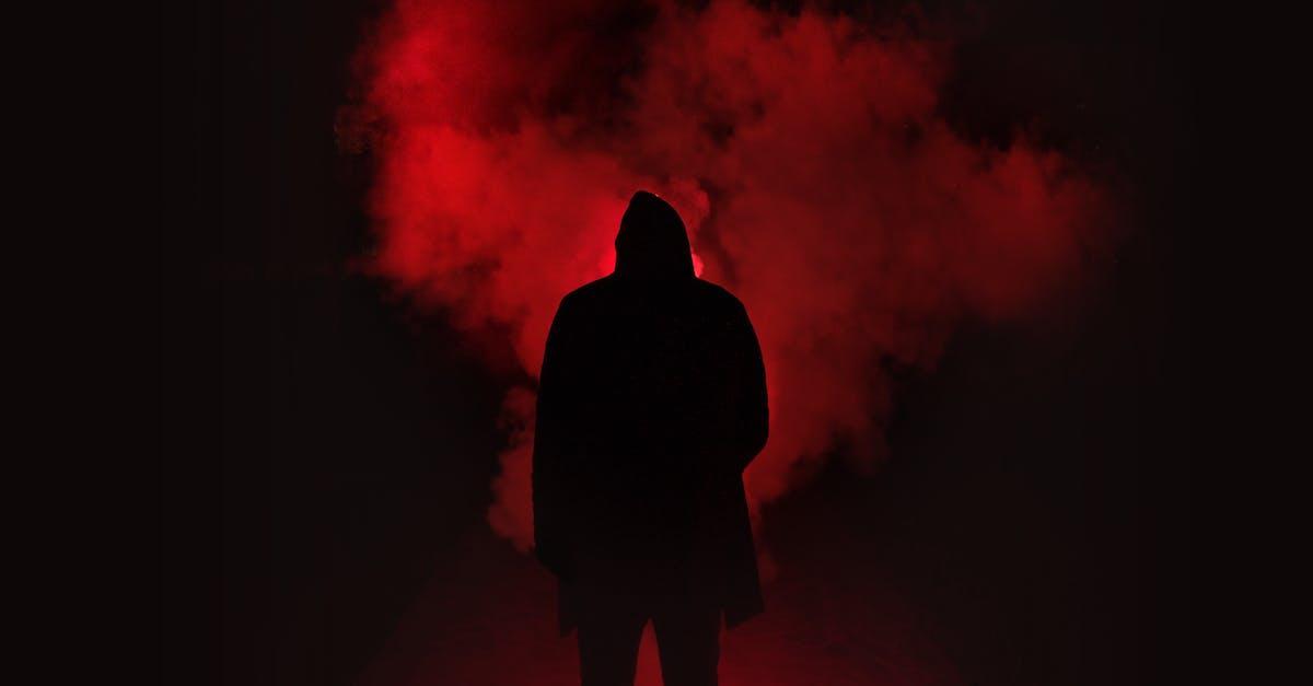 Silhouette of Man Standing Against Black And Red u003cbu003eBackgroundu003c/bu003e ...