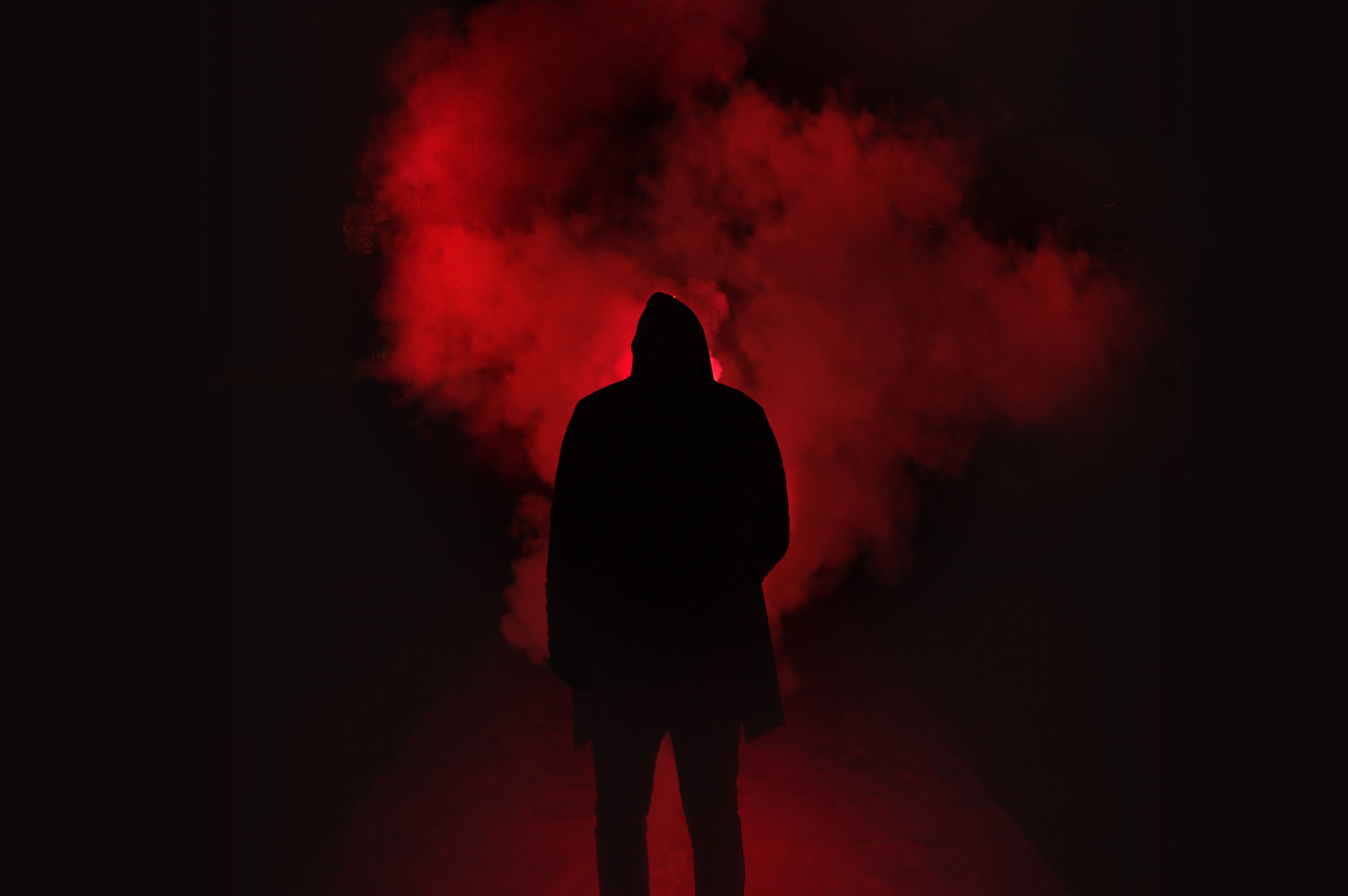 Black And Red >> Silhouette Of Man Standing Against Black And Red Background