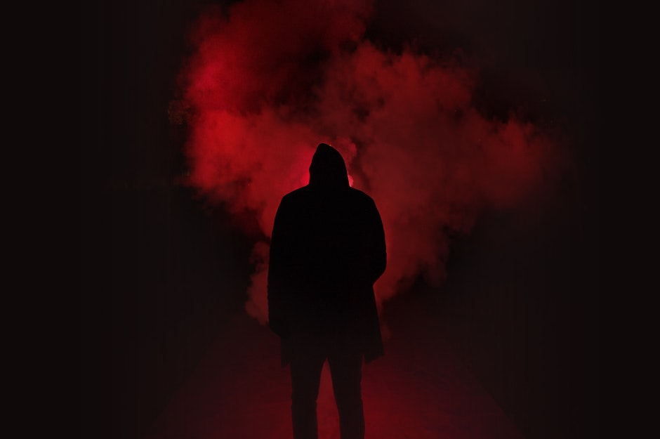 Background Black And Red >> Silhouette of Man Standing Against Black And Red Background · Free Stock Photo