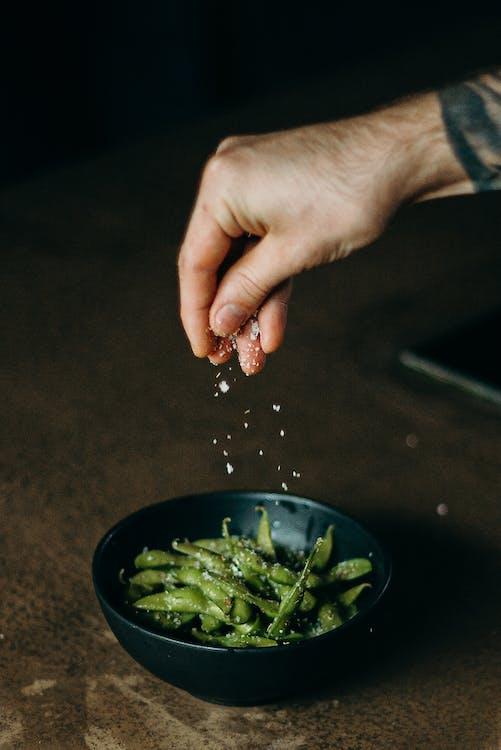 Pouring Salt on Green Beans