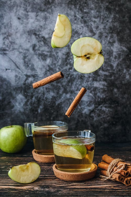 Photo of Slice Green Apple and Cinnamon Stick