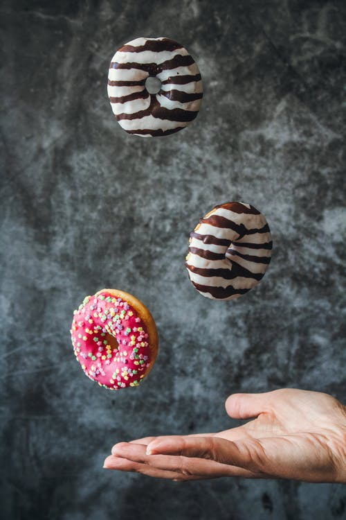 Photo Of Donuts In Mid Air