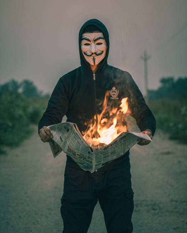 Man in Black Jacket Wearing A Face Mask