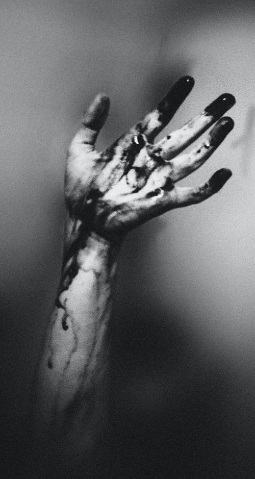 Photo of Hand with Dark Paint
