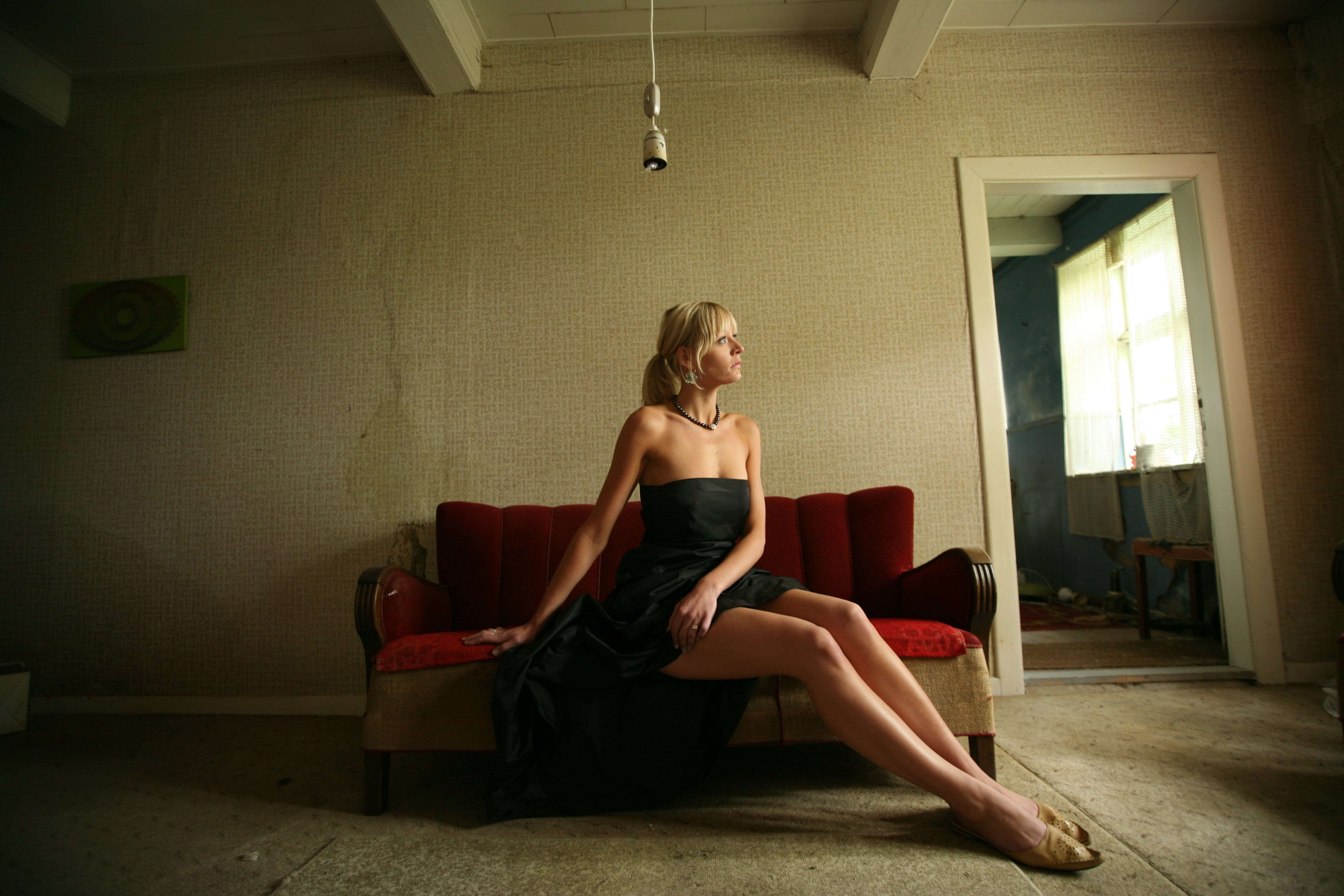 Women's Black Strapless Dress Sitting on Couch