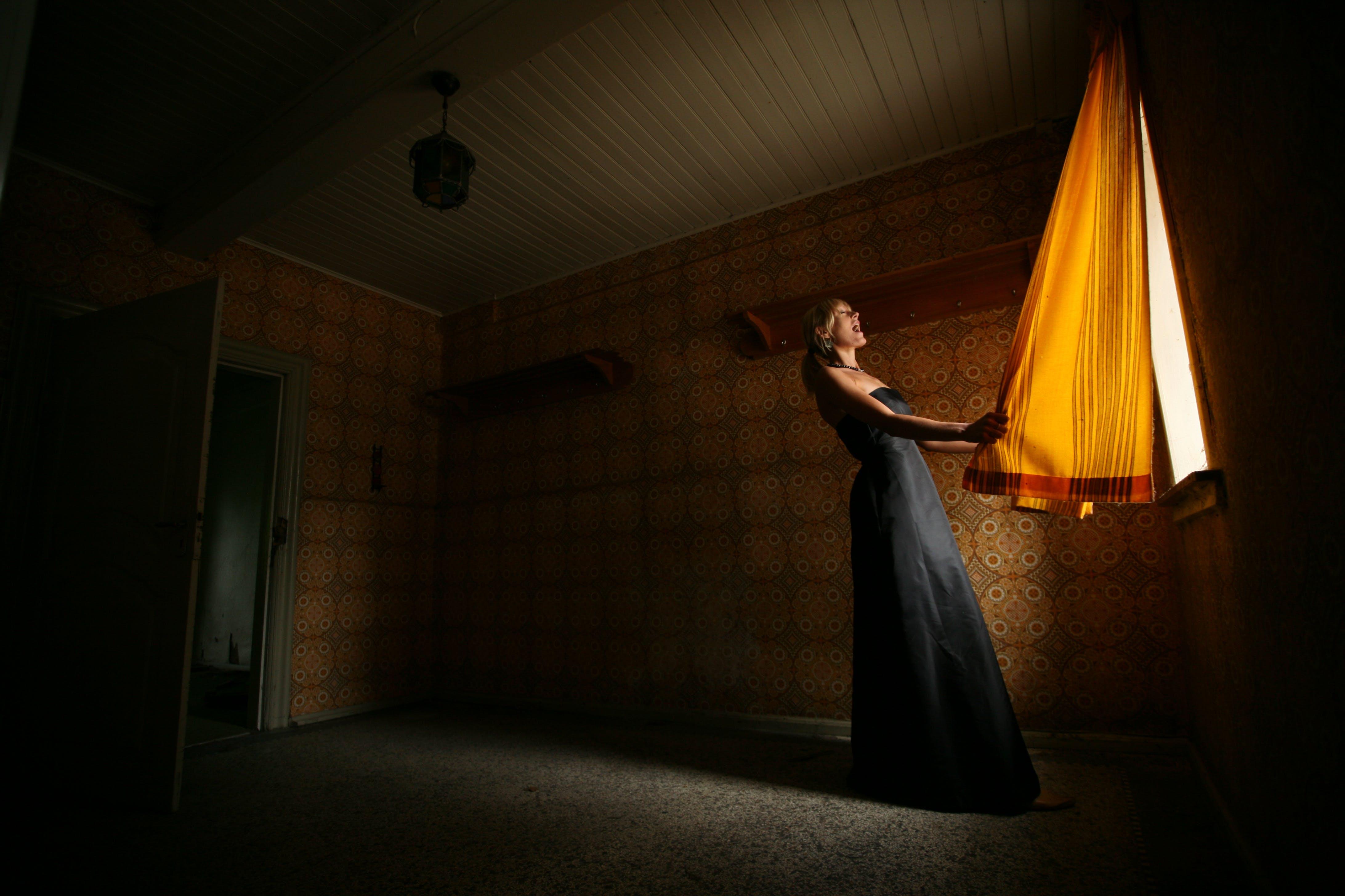 Woman Holding Brown Window Panel