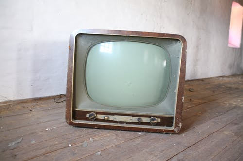 Vintage Brown Crt Tv on Parquet Wood Flooring