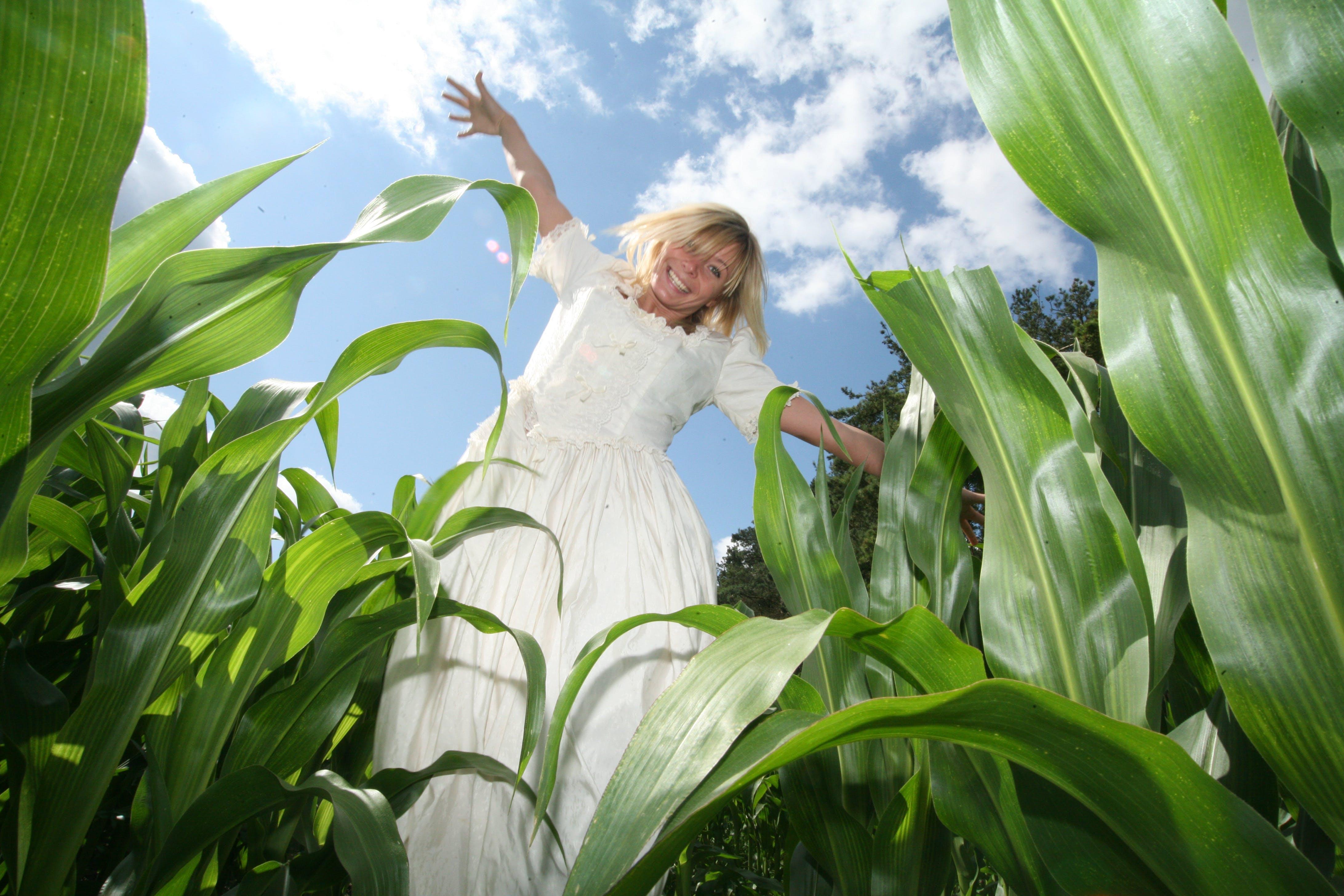 Woman Standing on Crop Field