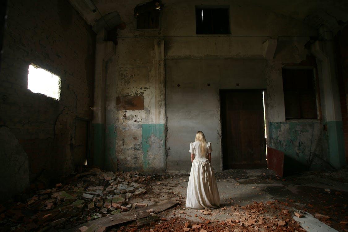 Woman Inside Abandoned Room