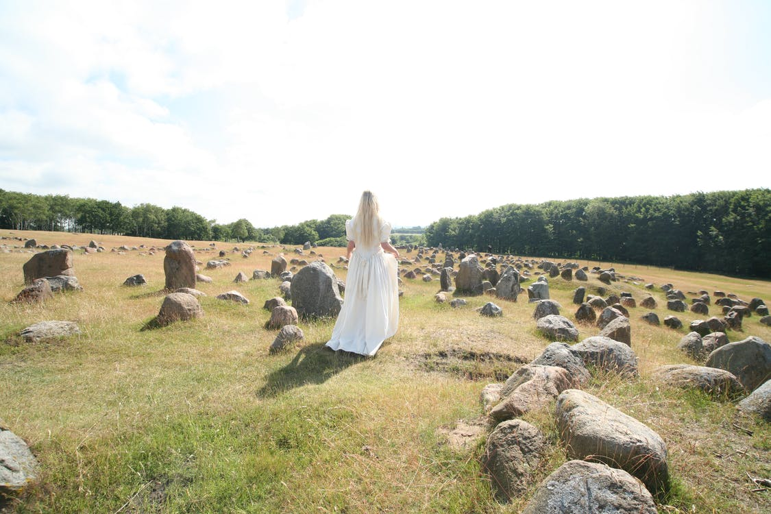 Woman Wearing Long Dress Standing Near Rocks
