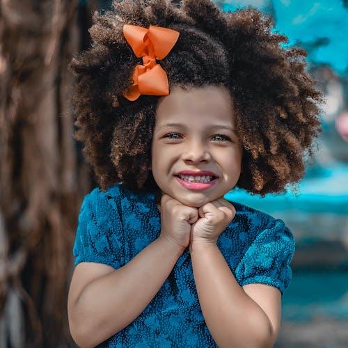 Girl Smiling Wearing Blue Shirt