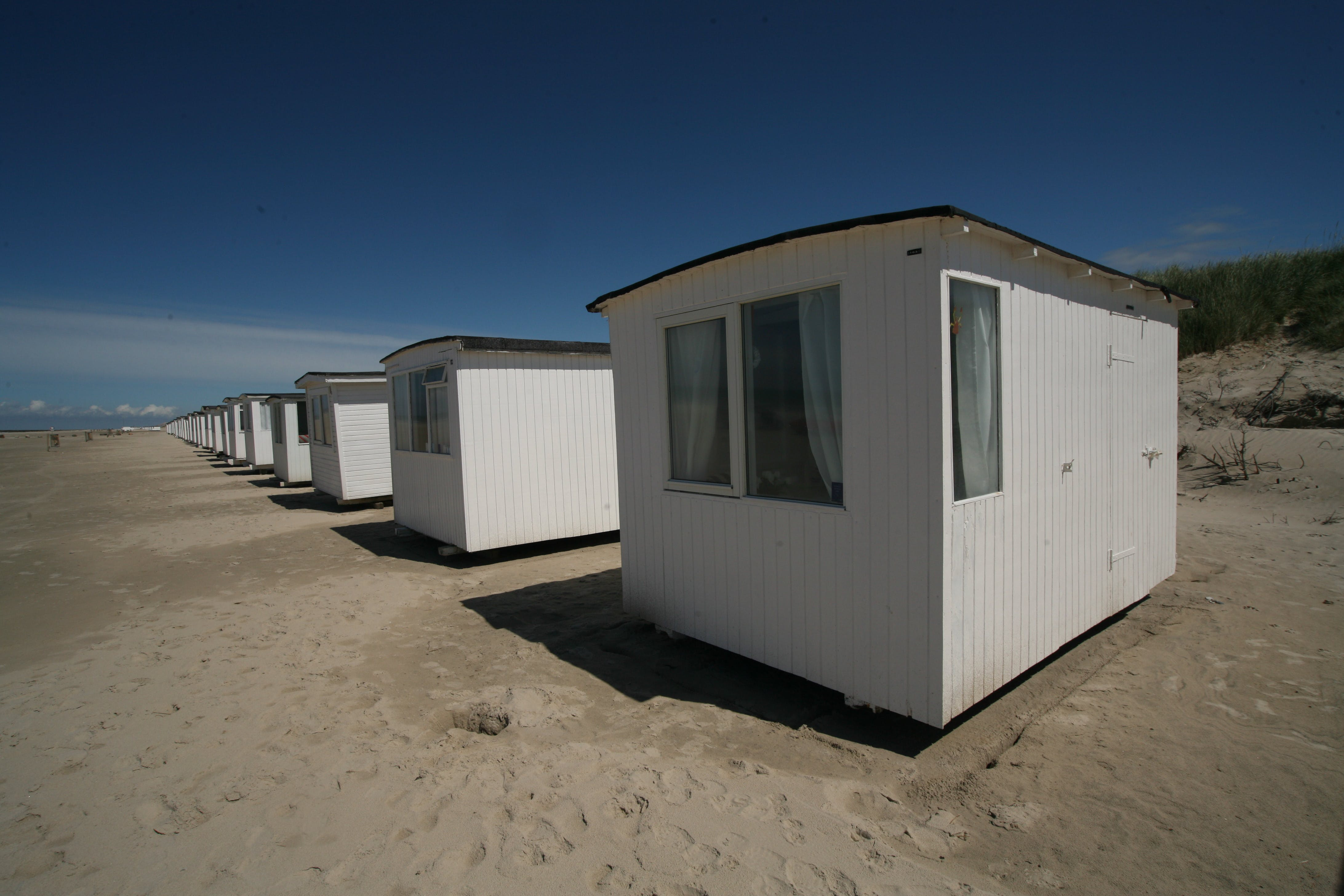 White Sheds on Gray Sands