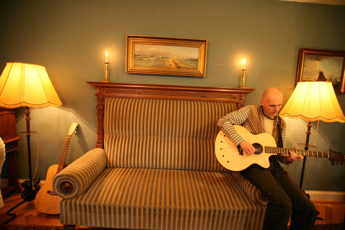 Free stock photo of couch, guitar, man